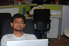 Picture of person falling asleep in the office