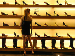 Girl looking at shoes and trying to decide
